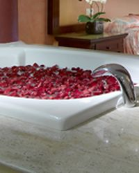 Jacuzzi prepared with flowers, candles and one type of aroma